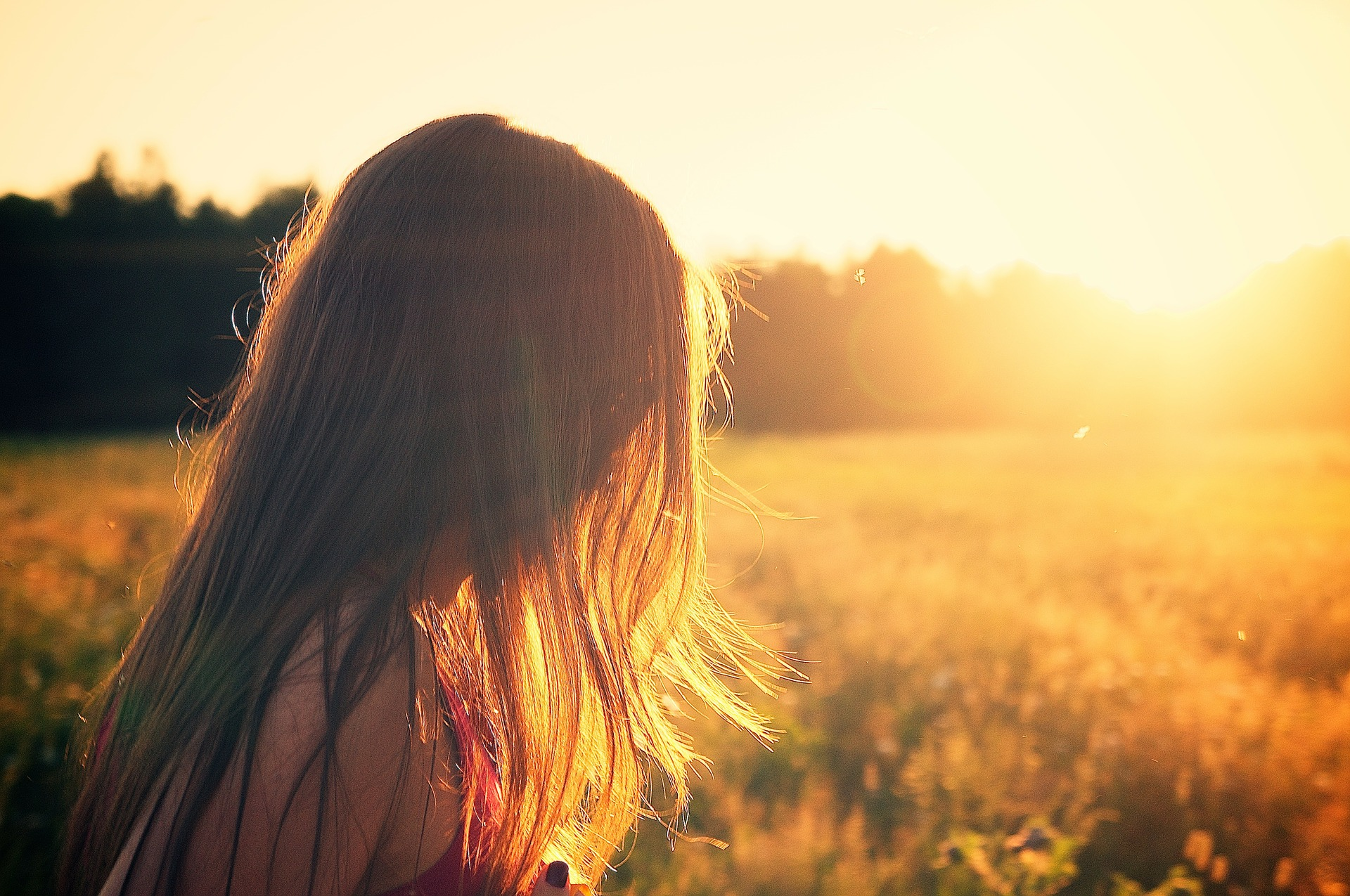 Girl in sunny field used for 6 Lessons Learned While Traveling
