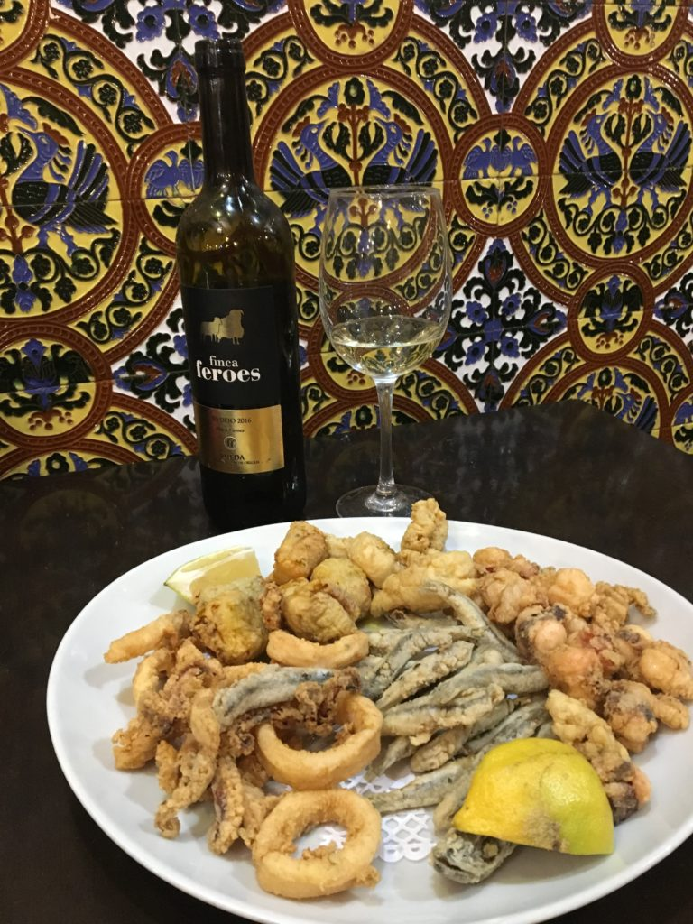 deep fried seafood and wine in Spain